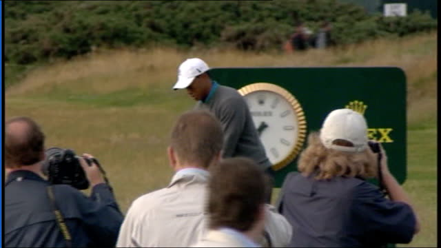 stockvideo's en b-roll-footage met tiger wood speaks to press woods on course and hitting ball as watched by press - british open