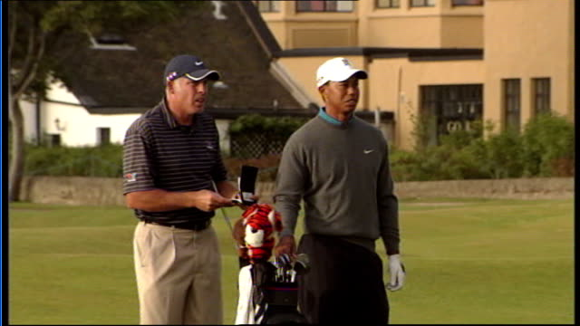 stockvideo's en b-roll-footage met tiger woods press conference and general views on golf course ext tiger woods chatting to people and along on golf course / woods swinging golf club... - british open