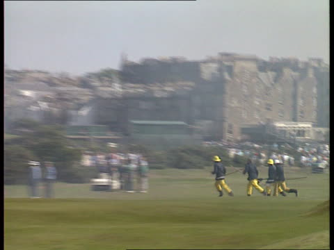 day 4 firemen running along as fire takes hold of gorse bushes - the open championship stock-videos und b-roll-filmmaterial