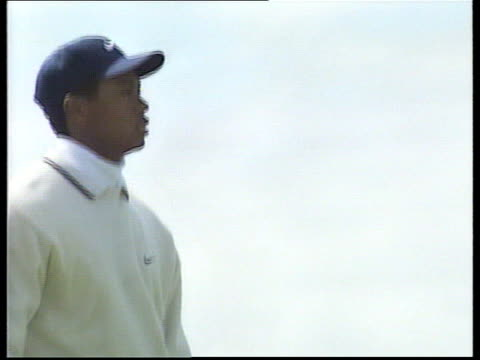 troon royal troon golf club ext crowd on course with sea beyond us masters champion tiger woods practising putting as crowds watch woods ken brown... - golf course stock videos & royalty-free footage