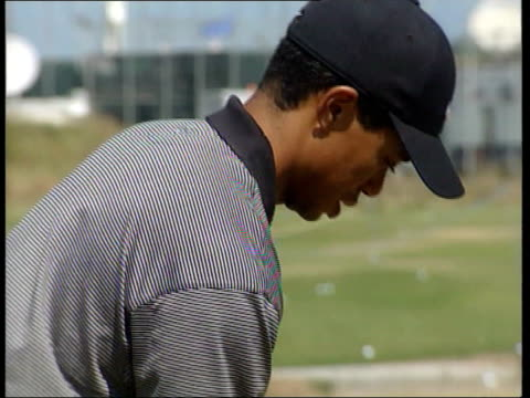st andrews cen peter scotland st andrews ext spectators standing behind fence at practice range tiger woods hitting ball on practice range woods... - tiger woods stock videos & royalty-free footage