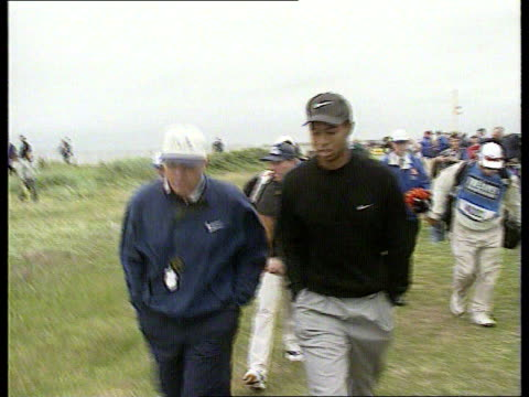 tiger woods practises scotland royal troon ext golfer tiger woods driving woods walking along fans along woods hitting shot people watching practise... - golf course stock videos & royalty-free footage