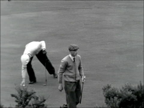 stockvideo's en b-roll-footage met first day england yorkshire harrogate ext ferguson on first tee / ferguson sinking putt on 5th green / kilpatrick driving off / butler putting /... - british open