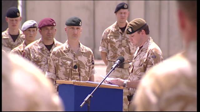 stockvideo's en b-roll-footage met british operations in iraq officially come to an end iraq basra ext british soldier saluting in front of memorial wall soldiers standing as listening... - padre