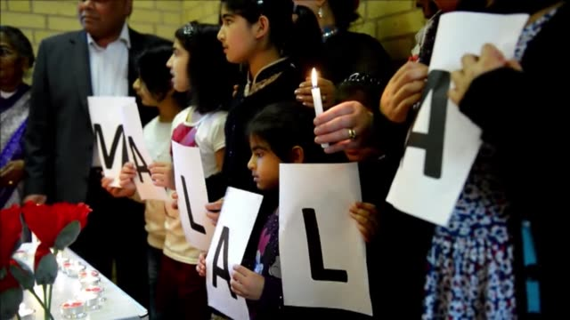 british pakistanis gathered in birmingham on saturday to mark the one month anniversary of the shooting of malala yousafzai a 15 year old girl who... - pakistan bildbanksvideor och videomaterial från bakom kulisserna