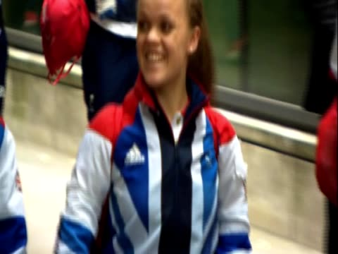 British paralympian swimmer Ellie Simmonds walks with Paralympics and Olympics athletes to the bus for the Team GB parade