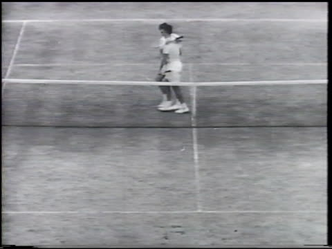 british paramount newsreel: seixas beats nielson: vs victor playing tennis at wimbledon, shaking hands w/ royalty. davis cup: vs game play, crowd.... - davis cup stock videos & royalty-free footage