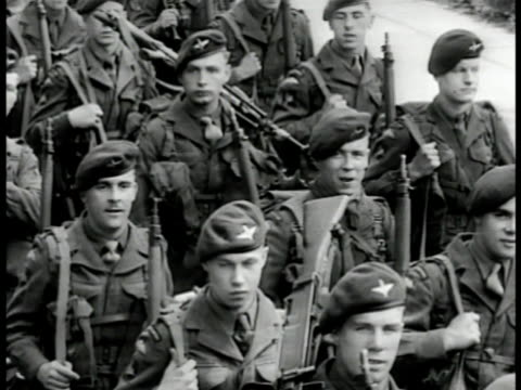 british paratroopers marching three abreast on street. marching paratroopers. british soldiers standing in formation on dock. soldiers carrying... - 1951 stock videos & royalty-free footage