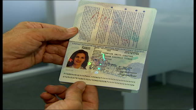 facetoface interviews to become compulsory Hands holding new biometric British passport as opens it to reveal electronic chip