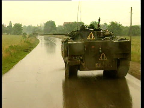 british peacekeeping vehicles in rain kosovo situation 18 jun 99 - 平和維持点の映像素材/bロール