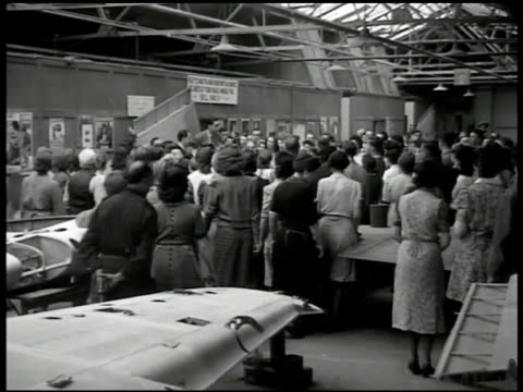 british pedestrians on street bicycles ha ws mechanics single engine airplanes in hangar dramatization ws workers around speaker microphone 'fulfill... - postwar stock videos and b-roll footage