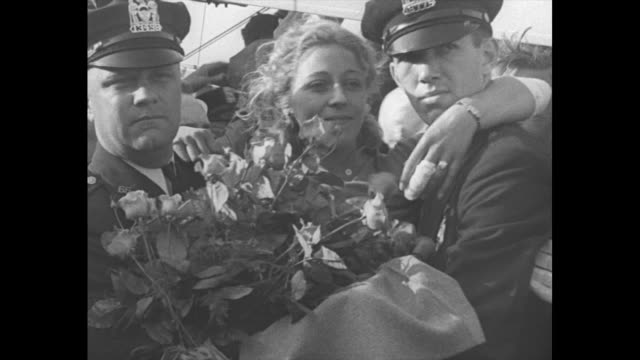 british pilot amy johnson mollison is lifted out of rescue plane by crowd of police and civilians crowded around / held by two nypd police officers,... - mid wales stock videos & royalty-free footage