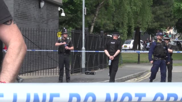 British police inspect a suspicious bag left near a building on Linby Street in Hulme on May 25 2017 in Manchester England Army bomb disposal units...