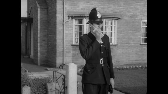 montage a british police officer leaving his home and receiving assignments via radio / chester, england, united kingdom - 英国チェスター点の映像素材/bロール