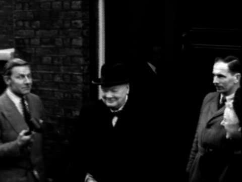 british politico winston churchill standing outside building, posing for and chatting with reporter / media journalists swarming car as winston... - 1950 stock videos & royalty-free footage
