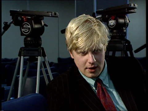 brussels side press taking notes cs hand as writing cms boris johnson intvwd sof with britain's departure from erm there was no attempt to give any... - boris johnson stock videos and b-roll footage