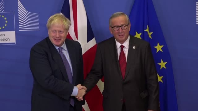british prime minister boris johnson and european commission chief jean-claude juncker hold a press conference in brussels after leaders agreed to a... - brussels capital region stock videos & royalty-free footage