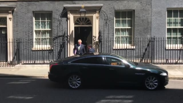 british prime minister boris johnson leaves 10 downing street to attend the final prime minister's questions at the house of commons before summer... - 10 downing street stock videos & royalty-free footage