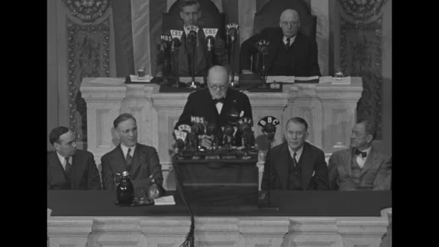ws british prime minister churchill speaking from rostrum in the us house of representatives' chamber of the us capitol vice president wallace and... - 1943 stock-videos und b-roll-filmmaterial