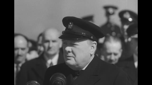 cu british prime minister churchill speaking into microphones wearing military cap british military leaders and sailors standing behind him on the... - us president stock videos and b-roll footage