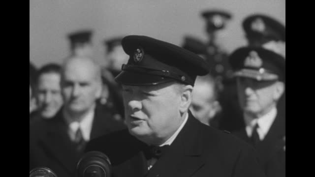 cu british prime minister churchill wearing military cap speaking into microphones on deck of hms prince of wales with british military leaders and... - winston churchill prime minister stock videos and b-roll footage
