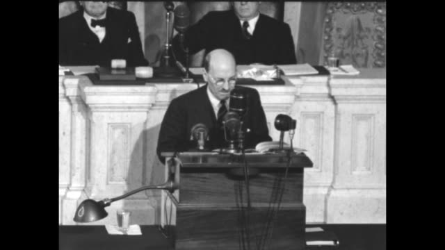 British Prime Minister Clement Attlee and officials enter House Chamber as Senators and Representatives stand and applaud / VS Senators and...