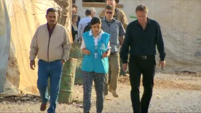 vídeos de stock, filmes e b-roll de british prime minister david cameron has visited a refugee camp in lebanon to see for himself the humanitarian crisis on the syrian border the prime... - david cameron político