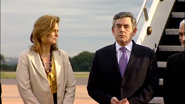 british prime minister gordon brown arrives for visit brown and wife sarah standing as bugle plays and military salute - bugle stock videos and b-roll footage