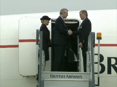 british prime minister john major emerges from concorde door and walks down steps before departing from heathrow he had flown in from washington... - british aerospace concorde stock videos & royalty-free footage