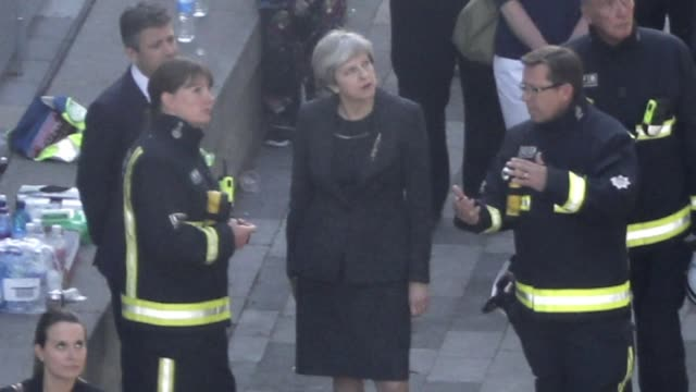 british prime minister may visits the site of a london tower block gutted by a blaze that has already left 12 dead - may stock videos & royalty-free footage