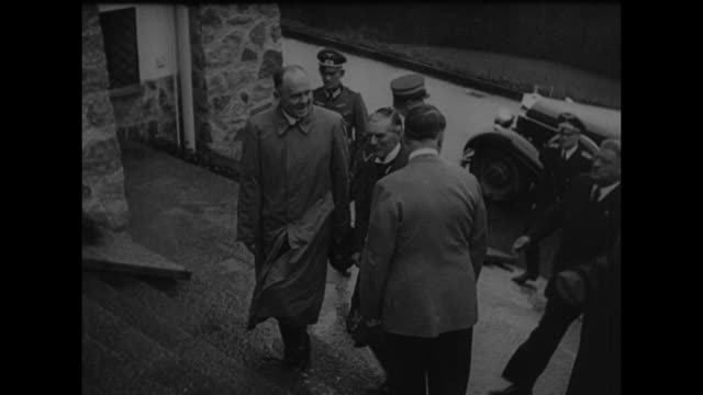 british prime minister neville chamberlain and german chancellor adolf hitler standing on steps of the berghof during chamberlain's visit to... - third reich stock videos & royalty-free footage