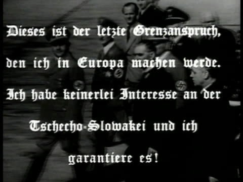 stockvideo's en b-roll-footage met british prime minister neville chamberlain walking w/ german nazi officers german lettering superimposed - 1938