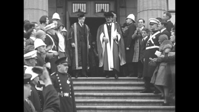 british prime minister ramsay macdonald is applauded as he descends steps wearing a cap and gown during ceremony conferring upon him an honorary... - cap stock videos & royalty-free footage