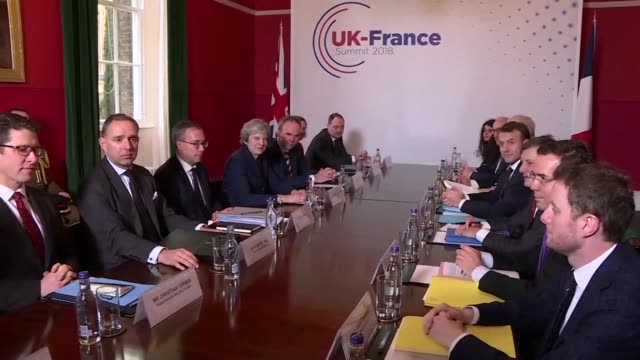 British Prime Minister Theresa May and her French counterpart Emmanuel Macron held a high profile summit at Britain's top military academy on...