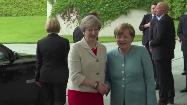 british prime minister theresa may arrives in berlin for the g20 preparatory meeting where european leaders will draw up a battle strategy a week... - group of 20 stock videos & royalty-free footage