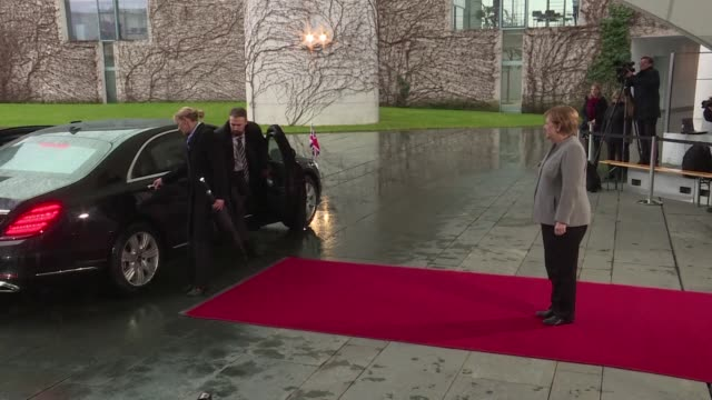 british prime minister theresa may is momentarily locked in her car while german chancellor angela merkel awaits to welcome her in berlin - may stock videos & royalty-free footage