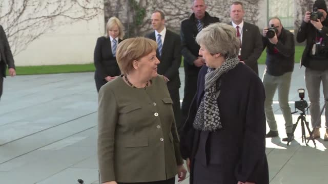 british prime minister theresa may is welcomed by german chancellor angela merkel in berlin in the first of visits with leaders of germany and france... - prime minister of the united kingdom stock videos and b-roll footage