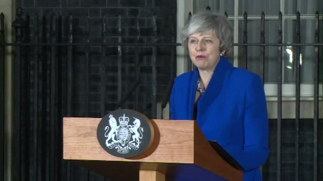 british prime minister theresa may makes a statement outside downing street saying it is her duty to deliver on brexit after her government survives... - defeat stock videos & royalty-free footage