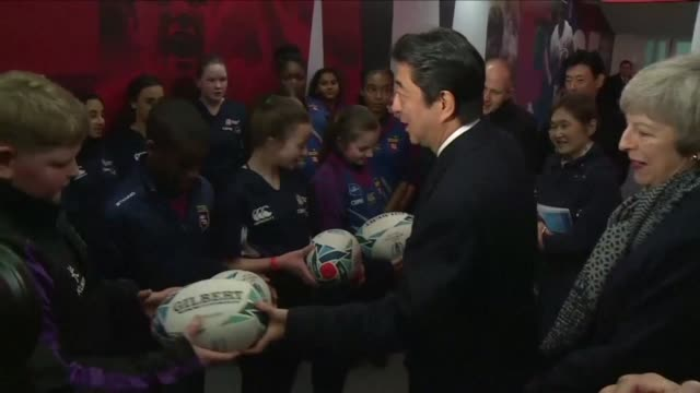 british prime minister theresa may shows her japanese counterpart shinzo abe around twickenham rugby stadium in london as japan prepares to host the... - afp stock videos & royalty-free footage