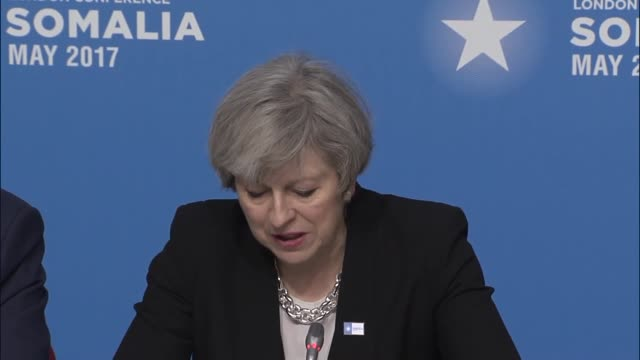 British Prime Minister Theresa May speaks during the London Somalia Conference in London on May 11 2017 More than 20 heads of state and government...