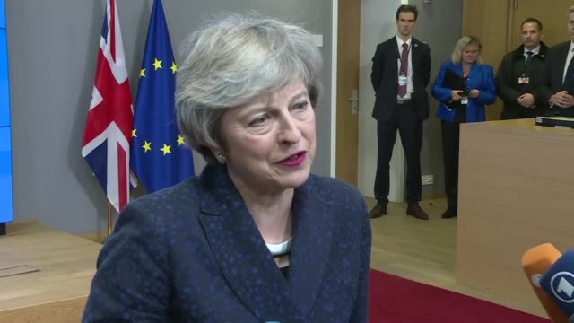 british prime minister theresa may vows to deliver brexit on time after meeting with eu leaders in brussels - may stock videos & royalty-free footage