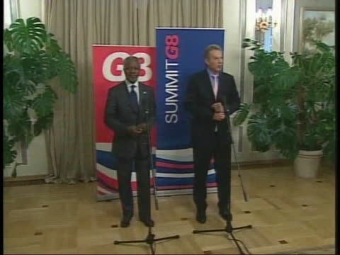 british prime minister tony blair and kofi annan walk to the microphones at the g8 summit. - (war or terrorism or election or government or illness or news event or speech or politics or politician or conflict or military or extreme weather or business or economy) and not usa stock videos & royalty-free footage