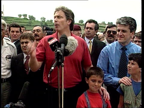 british prime minister tony blair mp along at refugee camp for kosovo albanians carrying flowers refugees applauding british prime minister tony... - serbia stock videos & royalty-free footage