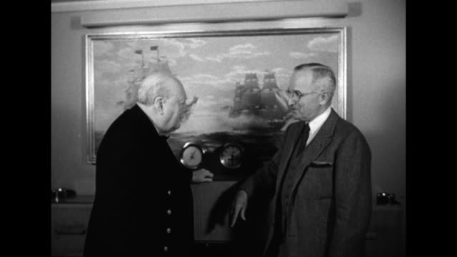 MS British Prime Minister Winston Churchill and US President Harry S Truman talk in front of a painting of a War of 1812 naval battle between the USS...