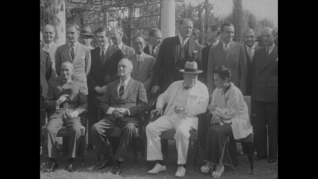 stockvideo's en b-roll-footage met cu british prime minister winston churchill chats with madame chiang kaishek during photo op us president franklin roosevelt sits beside him behind... - geallieerde mogendheden