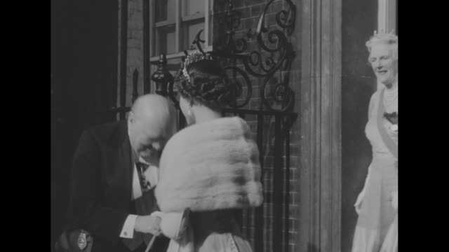 british prime minister winston churchill exits 10 downing street dressed in formal wear after announcing his resignation at dinner with queen... - winston churchill prime minister stock videos and b-roll footage