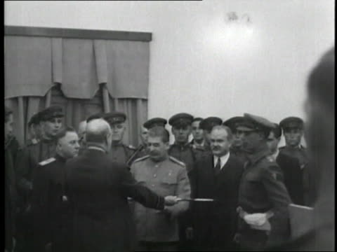 british prime minister winston churchill gives a sword to soviet premier joseph stalin during a ceremony as part of the tehran conference - 1943 stock videos & royalty-free footage