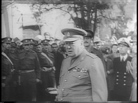 british prime minister winston churchill is well again and back on the job inspecting troops in tehran, iran / three british and sikh soldiers... - 1943 stock-videos und b-roll-filmmaterial
