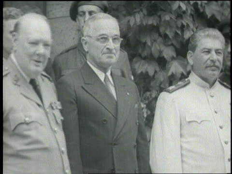 vídeos de stock, filmes e b-roll de british prime minister winston churchill president harry s truman and joseph stalin shake hands while posing for pictures at the potsdam conference - 1945