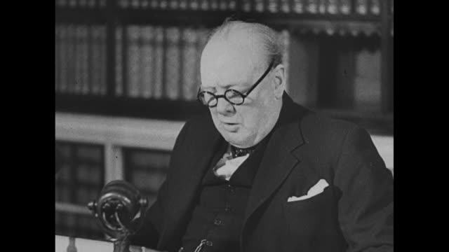 sot british prime minister winston churchill seated at microphone regarding ve day - surrendering stock videos & royalty-free footage